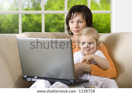 CLIPPING PATH! Mother with daughter on the sofa