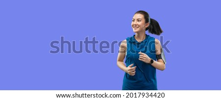 Clipping path portrait beautiful Asian women in sportswear run isolated on banner purple background. Healthy young woman runner happy smiling jogging. Stock foto ©