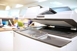 Cloceup bottom panel of the photocopier or xerox printer machine is office work tool equipment in copy room for scanning document and printout a paper.