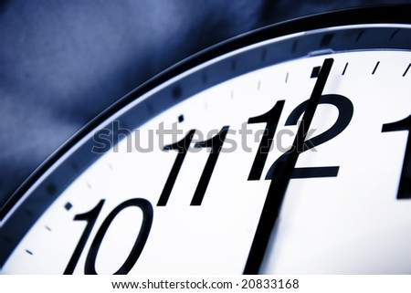 Clock about to show 12'o clock - new year, end is near, running out of time