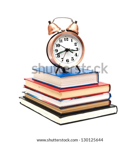 clock and books on a white background