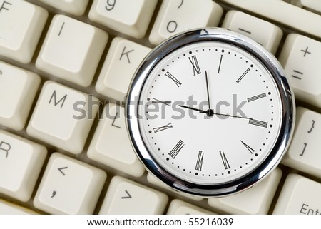 Clock and computer Keyboard close up