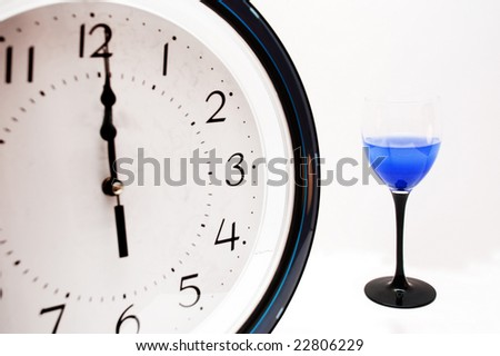 clock and glass with stem like clock hand