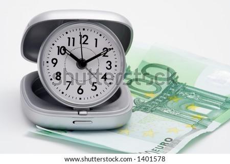 Clock and money (euros), isolated on white background