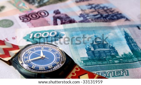 Clock and paper money