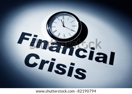 Clock and word of Financial Crisis for background - stock photo