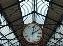 Clock at a traditional train staion. Words