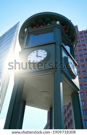 clock at Potsdamer Platz in Berlin. It is also the first traffic light in Berlin.                               Stock foto ©