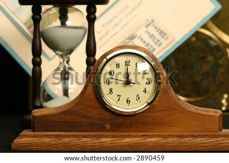 Clock, Calender, and Hourglass suggestive of time