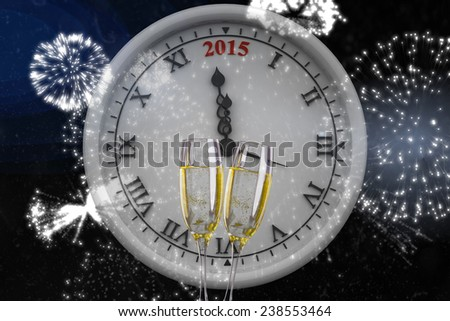 Clock counting to midnight against champagne