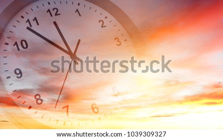Clock face in bright sky. Time passing #1039309327