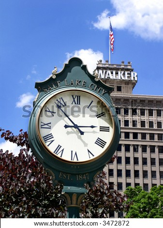 clock face in downtown Salt Lake City Utah USA with Walker Building behind