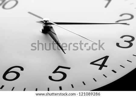 Clock face with focus on center. Time concept. - stock photo