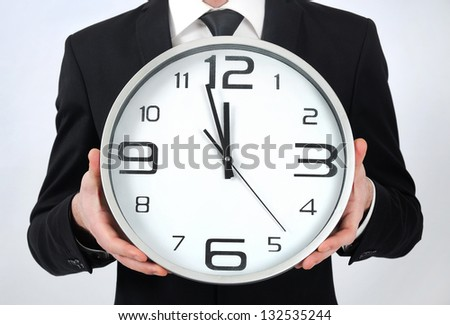 Clock in business man hands Foto stock ©