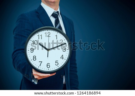 Clock in businessman hand. Businessman with a clock in a hand. Businessman with clock in time concept #1264186894