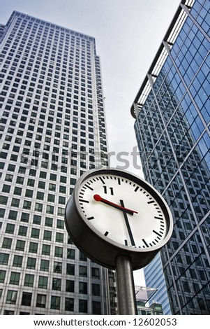 Clock in front of office buildings, London