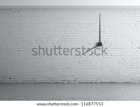 clock in white brick wall
