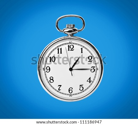 Clock isolated on blue background