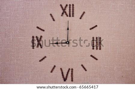Clock made of coffee beans. Nine o'clock