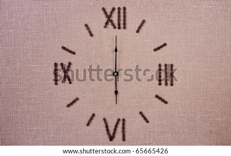 Clock made of coffee beans. Six o'clock - stock photo