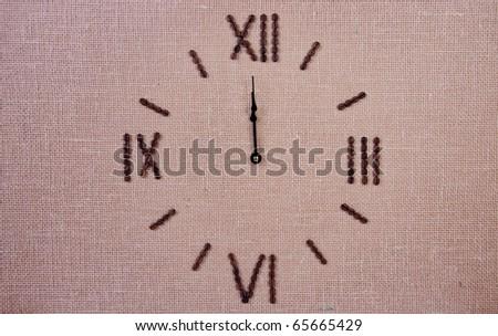 Clock made of coffee beans. Twelve o'clock