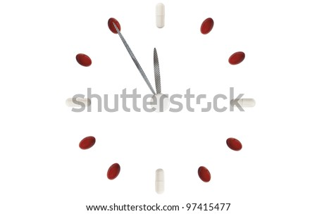 Clock made of pills warning, 5 to 12, isolated