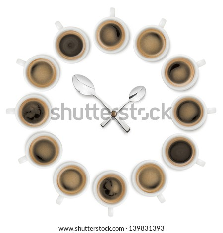 clock made with cups of coffee and teaspoon as lancets on white background