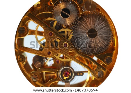 Clock mechanism close-up on a white background. Mechanical watches. Gears. Engine. Time.