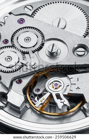 Clock mechanism with gears, close-up.