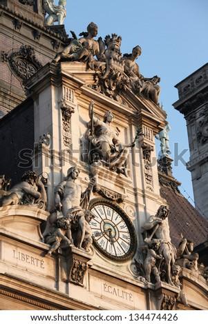 Clock of the Paris Town Hall in the Marais district of Paris, France.