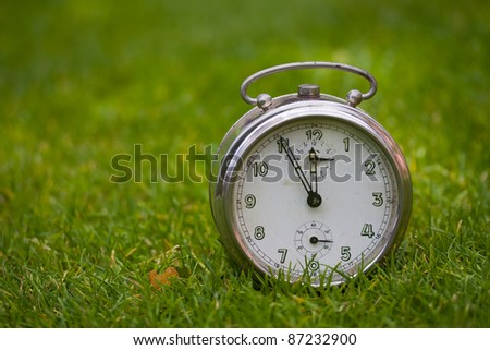 Clock on a grass