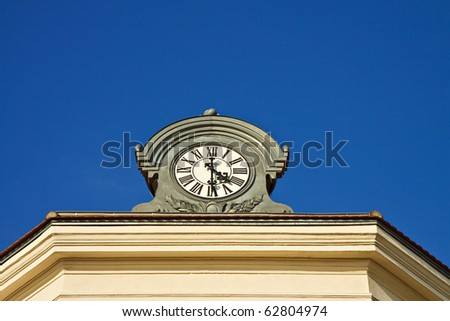 Clock on a roof in Radebeul (Germany).