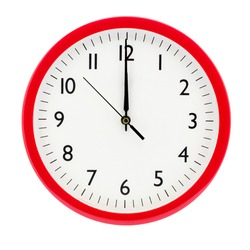 Clock on a white isolated background shows 12 o'clock on New Year's Eve