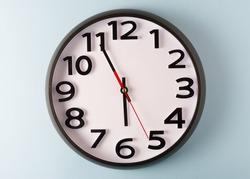 Clock on blue wall