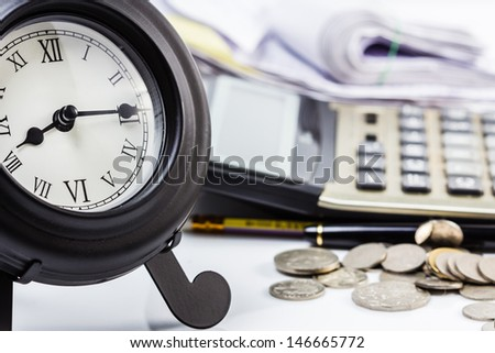 Clock on financial desk,concept of busy or working overtime