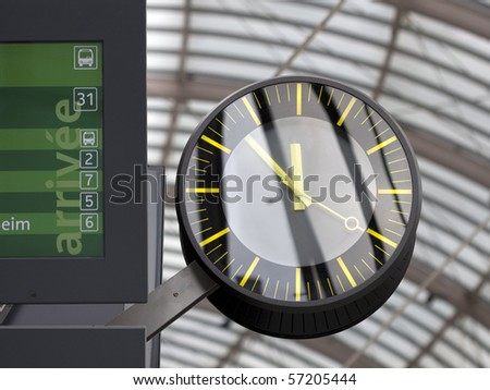 Clock on railway station with part of arrival panel in Strasbourg, France