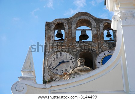 Clock on the very old tower with bells