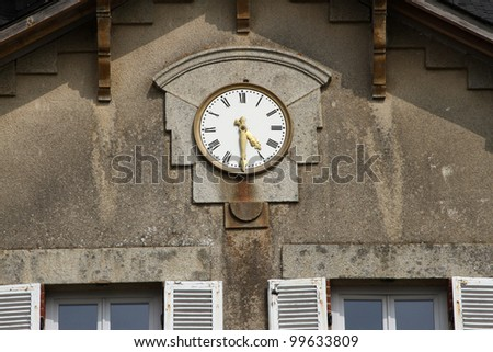 Clock on wall of historic french chateau mansion house