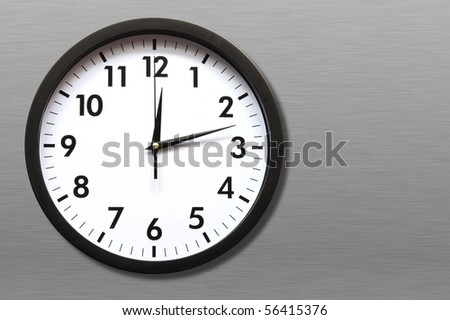 clock or watch on a wall with copyspace showing time concept