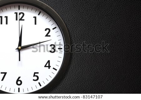 clock or watch on a wall with copyspace showing time concept - stock photo