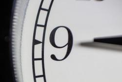 clock showing exactly nine a clock closeup