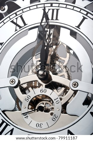 Clock showing time one minute before twelve