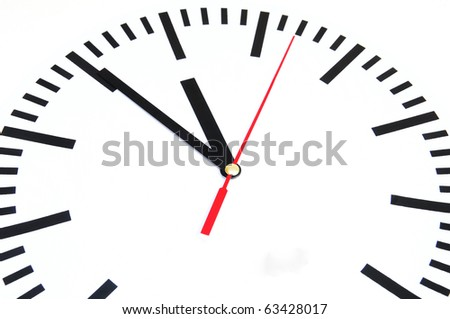 Clock shows five minutes to twelve
