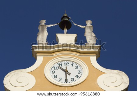 Clock Tower at Town Hall. Above the clock\'s bell and figures of two craftsmen. (Bardolino, Lake Garda, Italy)