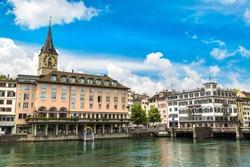 Clock tower in historical part of Zurich in a beautiful summer day, Switzerland