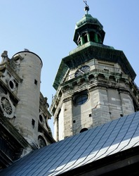 clock tower. medieval architecture. ancient clock on the tower of the old Catholic church. church with a tower with a green copper-plated dome and an antique clock