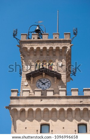 Clock tower of governament palace with clock bell and three mosaics of Saints Leo, Agatha and Marino