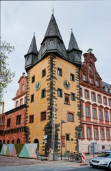 Clock tower of Historical museum in the city center of Frankfurt am Main in Germany. People on the background.
