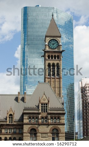 Clock tower of Toronto's Old City Hall against modern building