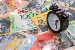 Clock with alarm at australian dollars close up